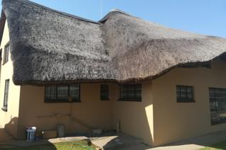 South of Witbank Mall with four flats of 1 bedroomed, kitchen, bath room and lounge. The main house is thatched with 3 bedrooms, a ...