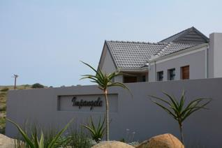 Modern coastal home available to rent at R10 500 per month, the house has 3 bedrooms, 2 ...