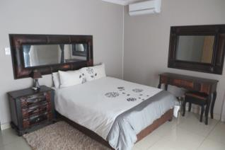 This fully furnished house has 4 bedrooms with 4 bathrooms.  Open plan lounge, dining room and kitchen with a built in braai on the ...