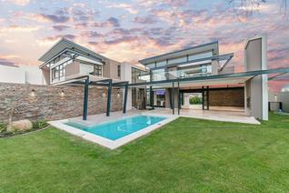 A stunning modern contemporary 4 bedroom home, with top finishes throughout. A rare opportunity to own a home within the prestigious ...