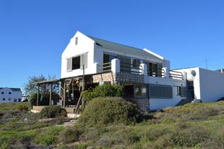 Sea front double storey home with spectacular views, space and comfortable living makes ...