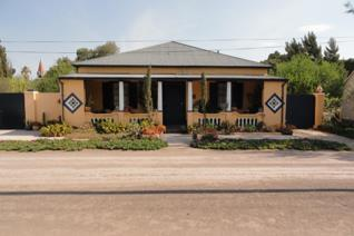 North facing character Karoo house for sale in quiet area of town. The main house ...