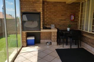 Wow!!! This safe, secure and spacious townhouse could belong to you. The living areas are open plan with dining room, lounge and ...