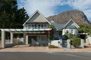 Tucked away in a secluded and quiet cul-de-sac in the exclusive Franschhoek Village is ...