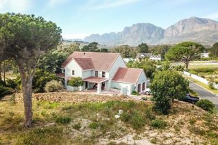 This extremely comfortable home is nestled in a sought after estate in the popular Hottentots Holland basin. The home is situated on a ...
