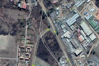 Located on two sides of a very busy T-Junction on main route to Heidelberg.    5.73 ha vacant land with business rights.  Municipal ...