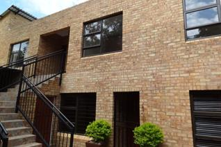 This upstairs unit in Baldwin Place with three bedrooms and two bathrooms is situated on ...