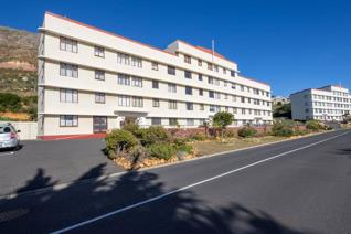 Warmth and relaxation welcome you as you step into this secure corner apartment with ...