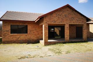 A neat three-bedroom house with an open plan kitchen and living area.  Kitchen with lots of cupboard space, breakfast nook, laundry ...