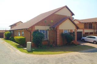 Well SECURED COMPLEX with 24 HOUR SECURITY!  This lovely CLUSTER HOME has so much SPACE ...