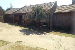 Family home in Die Heuwel Ext 1. Home has 4 bedrooms - with built in cupboards and 2 bathrooms - one en suite. Lounge, dining area and ...