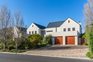 Residents to this spacious property are greeted by a grand entrance hall with double-volume ceilings and plenty of natural light. The ...