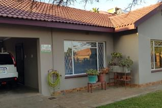 This home offers 4 bedrooms 2 bathrooms open plan kitchen dinning room with tv room ...