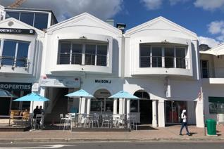 This well maintained retail space available to let has a balcony from which you can ...