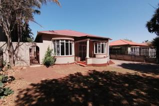This house is in the main street of Krugersdorp North, between Fifth & Sixth street. ...