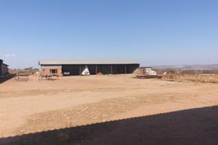 This site offers three massive workshops with a yard area for stock storage or vehicle storage.  There is no gravel road to the ...