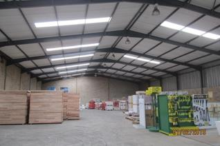 Two units are interlinked to create one big warehouse with 3 offices and bathroom facilities.  