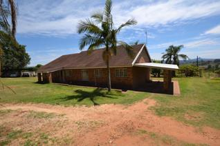 This 1 ha property offers 2 x 3 bedroom houses, over looking avo and litchi trees with ...