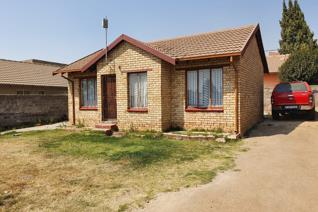 very neat three bedroom house with a very huge stand for further development  very close ...