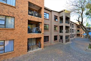 This neat apartment is set in a secure complex with swimming pool and visitors parking ...