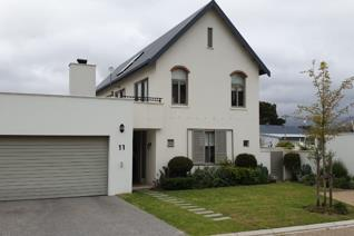 This modern house is perfectly situated in D'Olyfboom Hamlet Security Estate, within ...