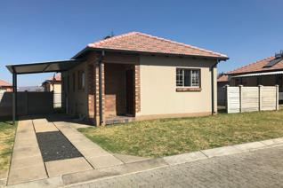 3 Bedrooms with fitted cupboards. Open plan Lounge and kitchen. 1 Bathroom. Separate toilet. Single covered carport plus extra ...
