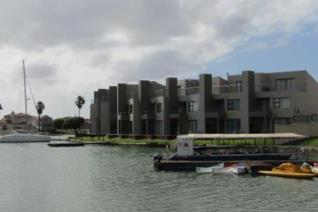 Sparkling water views compliment this modern three bedroom apartment in Port Owen.  The property boasts three floors. On the ground ...