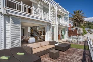 The ultimate beach bungalow situated in an exceptional position, bordering 1st and 2nd beach Clifton, with incredible ocean ...