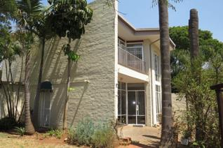 This sunny, spacious and secure duplex is well located and well built and ...