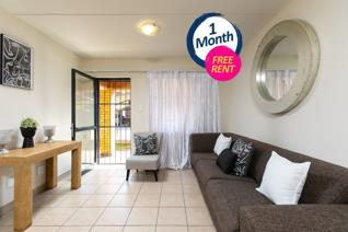 Spacious living areas, including a covered patio that is perfect for a relaxing weekend braai. Conveniently located just 5 min from ...