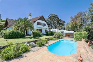 A gracious home nestled in a large established property with sea views, overlooking the the entire bay. An opportunity to step back in ...