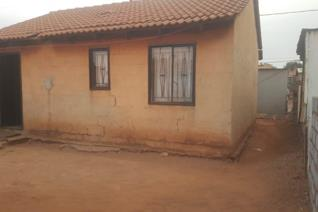 Two bed rooms house with dining room and kitchen, outside toilet in a  big yard. This ...
