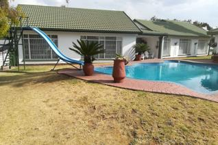 Close to schools and amenities sparkling pool, entertainment area, built in braai, bar beautiful garden, borehole and sprinkler ...