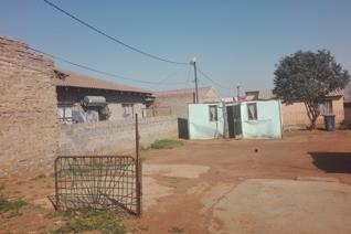 Very big stand for sale in orange farm with big yard. Call sms or whatsapp us to arrange viewing- cash buyers only.