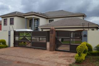 This low maintainance family house offers great space and security for the whole family,this is what we call a property to run for it ...