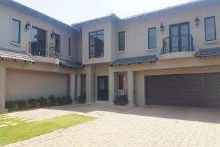 Located in the upmarket and very secure Carlswald Estate, this stylishly designed 4 ...