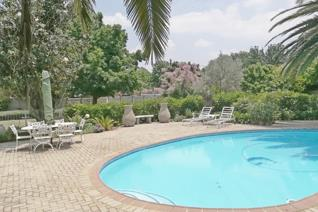 This beautiful home offers you and your family a lovely peaceful garden with sparkling blue swimming-pool.  Stunning kitchen with ...