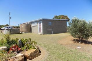 """""""This 9ha smallholding is situated 500m from the Vleesbaai border and 1km from the beach. It has beautiful views of the valley ..."""