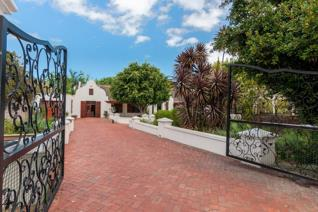 A landmark property, in a perfect cul-de-sac, and a residence that exudes warmth, character and charm.   This beautiful home ...