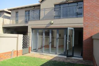 This lovely property comprises a tiled open plan lounge, dining room and kitchen. The lounge has a built-in braai and leads through ...