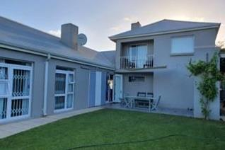 Open plan kitchen leading to pantry and scullery Spacious living area 4 Bedrooms Main en ...