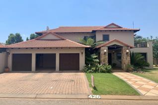 This Beautiful 4 Bedroom Home is set in Ruimsig Country Estate, This house is set on 2 ...