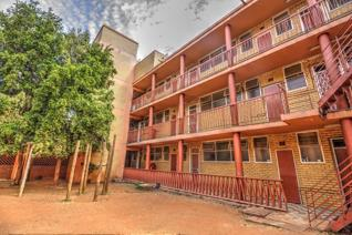 Lovely second floor apartment offers a spacious, open plan, tiled lounge with doors that ...