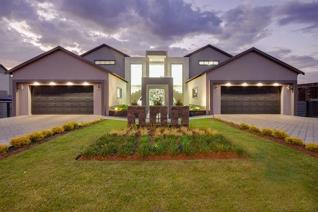 Walking through the Magnificently Landscaped Garden, you enter the entrance hall with its dual stairway leading to the Upstairs Area.  ...