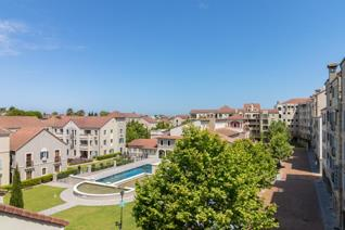 Stunning, secure and private north facing top floor corner apartment situated in Bella ...