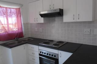 Up market Bachelor apartment w/loft. Open plan kitchen with built-in oven and hob , with extractor fan. Lots of built in cupboards in ...