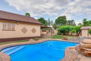 3 Bedrooms 2 Bathrooms Double Garage View & Pool  Situated in the pretty suburb of ...