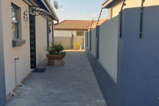 Stunning modern 3 bedroom and 2 bathroom townhouse with swimming pool in quiet area for sale