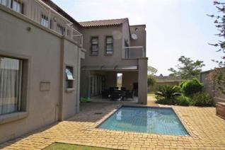Double storey delight with a sparkling pool  Spacious family home available immediately for occupation. Open plan living spaces opens ...