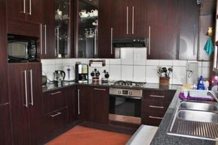 This well-kept home boasts a modern kitchen with ample cupboard space, a convenient laundry room and is open plan to a smaller dining ...